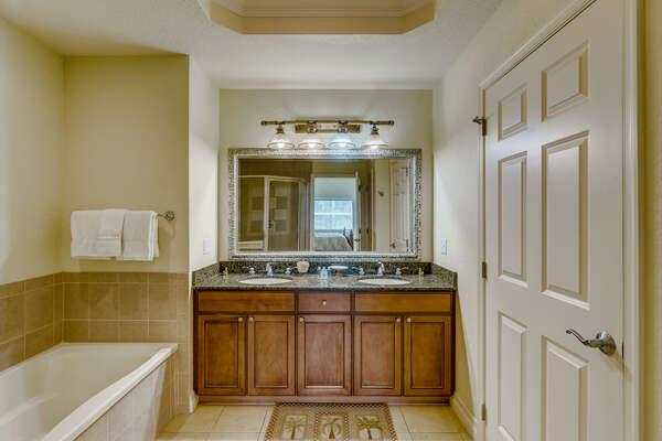 Ensuite bathroom has dual vanity, garden tub and walk-in shower