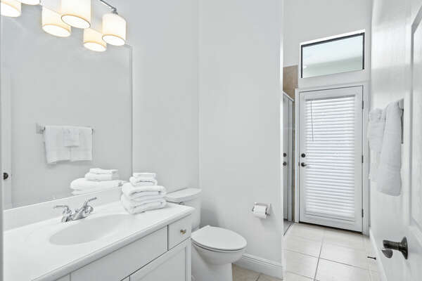 Pool side bathroom with walk in shower