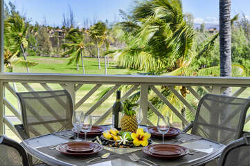 Table Setting at Outdoor Dining Area with Wind-Swept Palm Trees