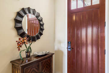 Entryway with Round Mirror and Wooden Console