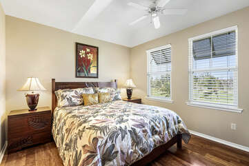 Master Bedroom with Tropical Decor and Large Windows