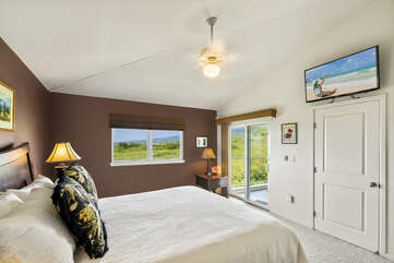 Master bedroom with mounted HD TV
