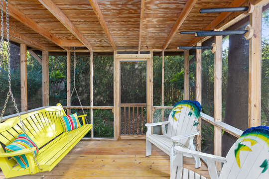 Screened in Patio with yellow swing