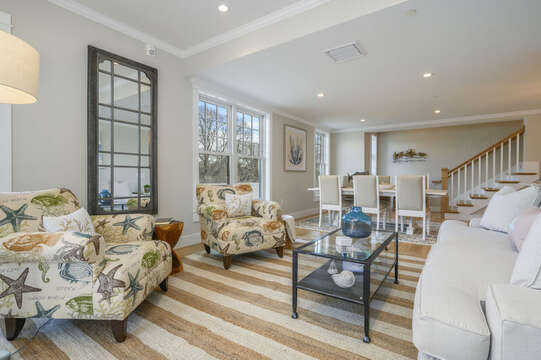 Living room with comfortable seating in a coastal flair. Unit 201, 557 Route 28 Harwich Port, Cape Cod, New England Vacation Rentals