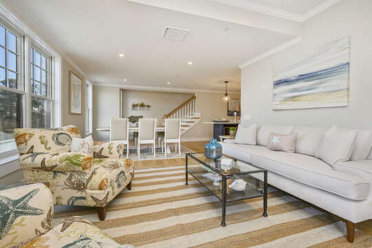 Living area with ample seating that looks into the  dining area. Unit 201, 557 Route 28 Harwich Port, Cape Cod, New England Vacation Rentals