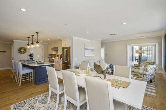 Open Concept Kitchen-Dining area that looks into living room and balcony. Unit 201, 557 Route 28 Harwich Port, Cape Cod, New England Vacation Rentals
