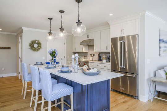 Luxury Chefs Kitchen with all stainless appliances and walk in pantry with washer and dryer. Unit 201, 557 Route 28 Harwich Port, Cape Cod, New England Vacation Rentals