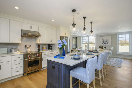 Open concept Kitchen - Dining area with island with seating for 3. Unit 201, 557 Route 28 Harwich Port, Cape Cod, New England Vacation Rentals