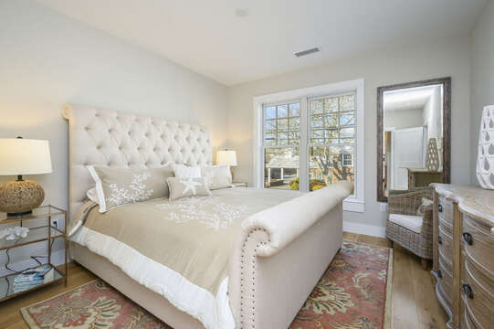 King size plush bed,  occasional chair and dresser. Unit 201, 557 Route 28 Harwich Port, Cape Cod, New England Vacation Rentals