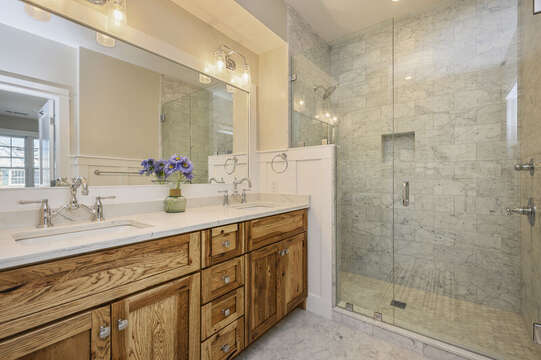 En-suite bath in King bedroom, double vanity and extra large step in shower. Unit 201, 557 Route 28 Harwich Port, Cape Cod, New England Vacation Rentals