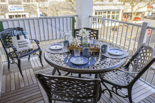 Enjoy morning breakfast as you people watch over downtown Main Street. Unit 201, 557 Route 28 Harwich Port, Cape Cod, New England Vacation Rentals