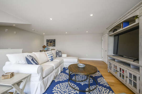 Comfy seating  and large flat screen tv for watching your favorite shows located on the second floor bonus room. Unit 201, 557 Route 28 Harwich Port, Cape Cod, New England Vacation Rentals
