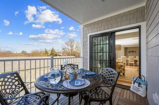 A Lovely way to start the day - covered balcony off living room. Unit 201, 557 Route 28 Harwich Port, Cape Cod, New England Vacation Rentals