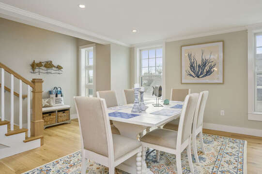 Dining area with seating for 6 and stairs to upper bonus room with roof top deck.Unit 202, 557 Route 28 Harwich Port, Cape Cod, New England Vacation Rentals