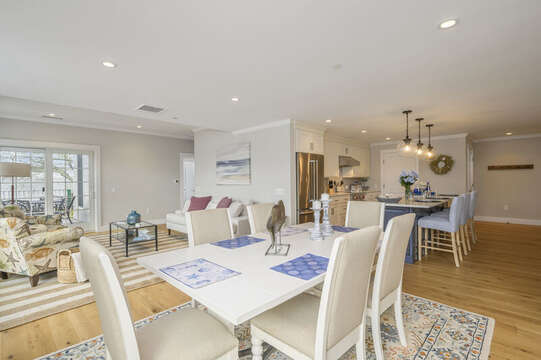 Open concept dining room and Living room with entrance to private patio. Unit 202, 557 Route 28, Harwich Port, Cape Cod, New England Vacation Rentals