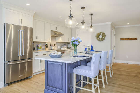 Beautiful Chefs kitchen with seating for 3 at the center island with all stainless appliances.Unit 2, 557 Route 28, Harwich Port, Cape Cod, New England Vacation Rentals
