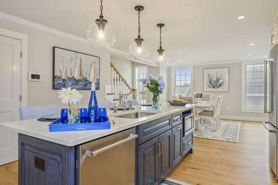 Luxury open concept kitchen and dining room with dishwasher and microwave in large island Unit 2, 557 Route 28 Harwich Port, Cape Cod, New England Vacation Rentals