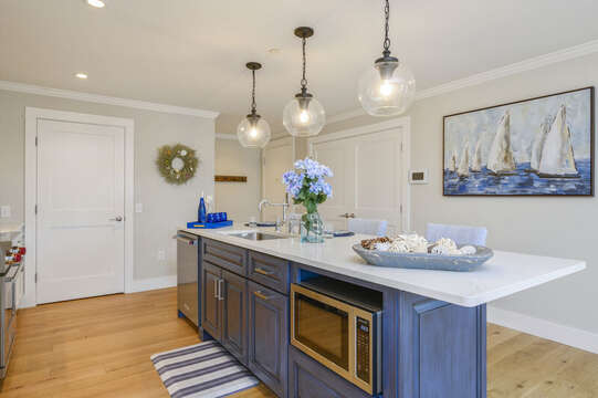 Large kitchen with island seating for 3 pantry closet and separate laundry is through the double doors. Unit 2, 557 Route 28, Harwich Port, Cape Cod, New England Vacation Rentals