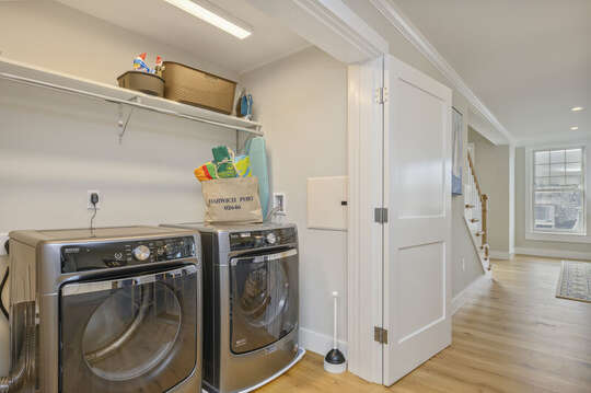 Laundry area in large  double closet across from kitchen. Unit 202, 557 Route 28, Harwich Port Cape Cod, New England Vacation Rentals