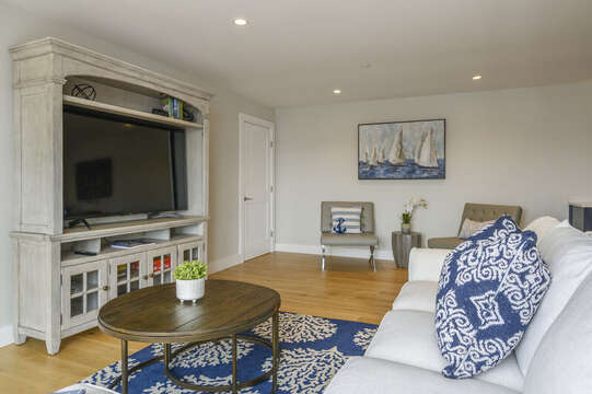 Second floor bonus room with large flat screen tv comfortable couch and leather chairs to enjoy the game.Unit 202 557 Route 28, Harwich Port, Cape Cod, New England Vacation Rentals