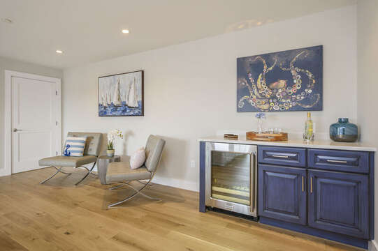 Dry bar in second floor bonus room with 2 leather chairs. Unit 202, 557 Route 28, Harwich Port, Cape Cod, New England Vacation Rentals