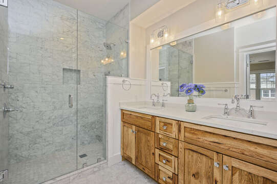 En suite bathroom with double vanity and large walk in Shower.Unit 202, 557 Route 28, Harwich Port, Cape Cod, New England Vacation Rentals
