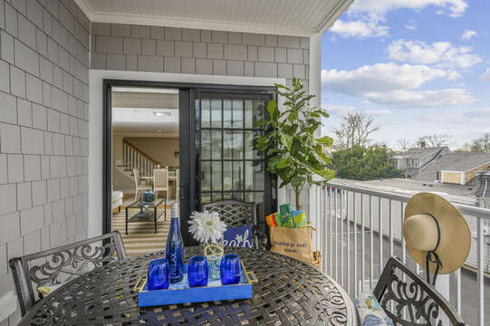 Private outdoor balcony entrance is off living room Unit 202 557 Route 28 Harwich Port Cape Cod New England Vacation Rentals