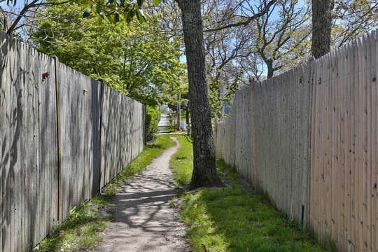 Path to Bank St Beach, located at the rear of the parking lot. 557 Route 28, Harwich Port, Cape Cod ,New England Vacation Rentals