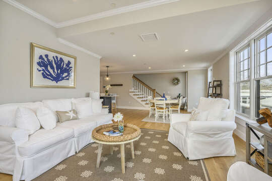 Living room with plenty of comfortable seating opens to dining room and stairs to second level bonus room.Unit 203,557 Route 28, Harwich Port Cape Cod, New England Vacation Rentals