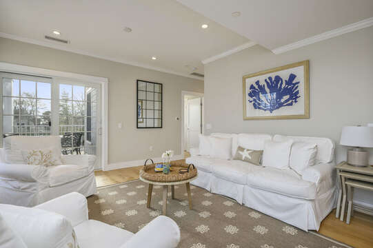 Living room with 2 occasional chairs and comfy couch.Unit 203, 557 Route 28, Harwich Port, Cape Cod, New England Vacation Rentals