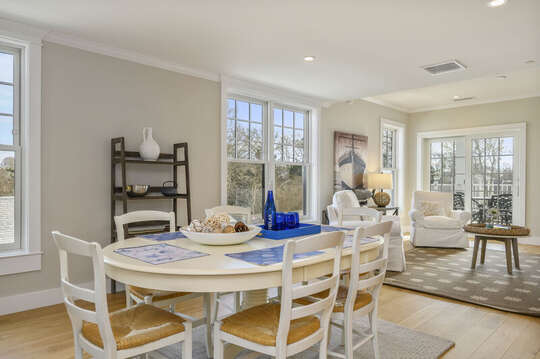 Open Concept dining and living area with seating for 6, 2 occasional chairs and entrance to private balcony. Unit 203,557 Route 28, Harwich Port ,Cape Cod, New England Vacation Rentals