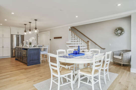 Open Concept Kitchen and dining with seating for 6 and entrance to second level.Unit 203, 557 Route 28, Harwich Port, Cape Cod, New England Vacation Rentals
