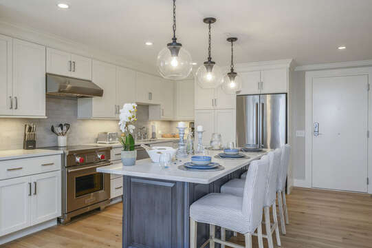 Large kitchen with center island stainless fridge and chefs range. Unit 203 557 Route 28, Harwich Port, Cape Cod, New England Vacation Rentals
