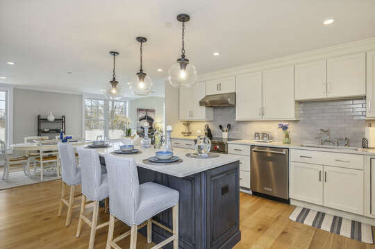 Luxury open concept kitchen with large center island with seating for 3 Dishwasher and chefs range.Unit 203, 557 Route 28, Harwich Port, Cape Cod, New England Vacation Rentals