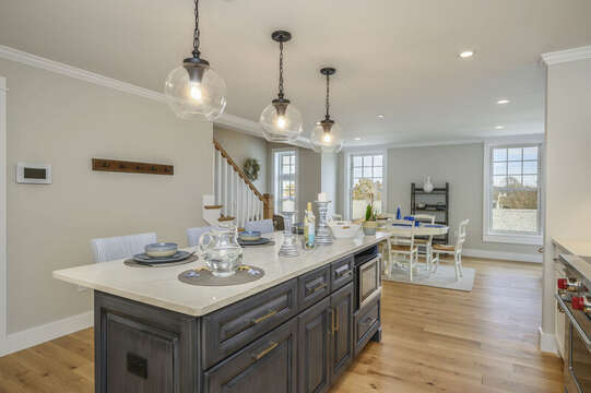 Open concept Kitchen and Dining area with Microwave in center island. Unit 203, 557 Route 28, Harwich Port, Cape Cod, New England Vacation Rentals