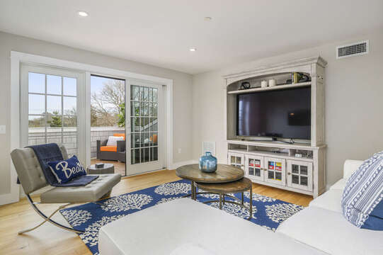 Second floor bonus room with Large flat screen tv , leather chair and sectional couch with Chaise lounge, access to roof top terrace! Unit 203,557 Route 28, Harwich Port, Cape Cod, New England Vacation Rentals