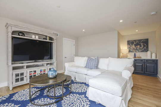 Bonus room with Large flat screen tv, comfy sectional and dry bar.Unit 203, 557 Route 28, Harwich Port, Cape Cod, New England Vacation Rentals