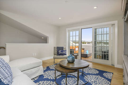 Second Floor bonus room with sectional couch , leather chair and private roof top terrace.Unit 203, 557 Route 28, Harwich Port, Cape Cod, New England Vacation Rentals