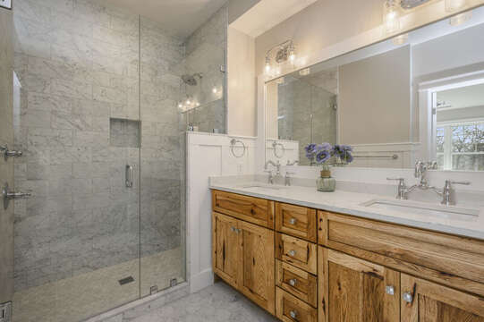 Bedroom 1,en suite bathroom with double vanity and large walk in shower.Unit 203, 557 Route 28, Harwich Port, Cape Cod, New England Vacation Rentals