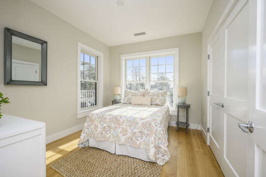 A bright room with Queen bed with dresser ,2 night stands and large closet. Unit 203, 557 Route 28, Harwich Port, Cape Cod, New England Vacation Rentals