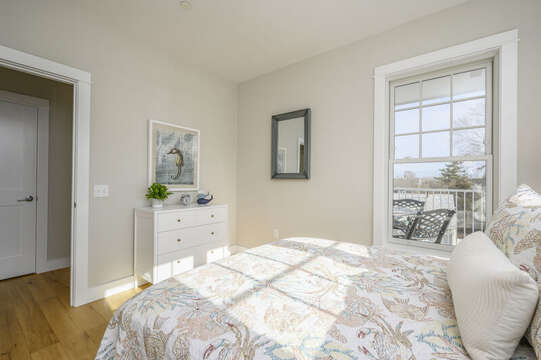 A bright room with Queen size bed, dresser. Unit 203, 557 Route 28, Harwich Port, Cape Cod, New England Vacation Rentals