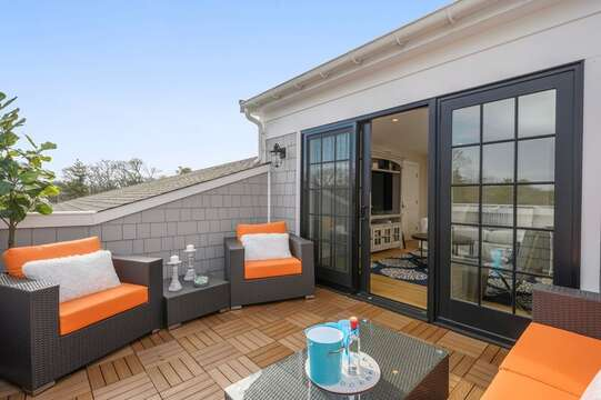 Roof Top Terrace with ample comfortable seating to relax and enjoy family and friends. Unit 203,557 Route 28, Harwich Port, Cape Cod, New England Vacation Rentals