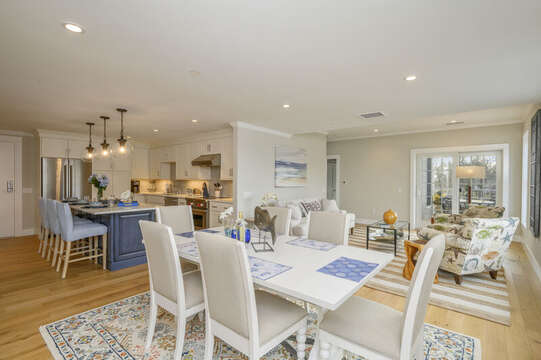 Open Concept Dining/ living area with seating for 6. Entrance to private outdoor patio.Unit 204, 557 Route 28 Harwich Port Cape Cod New England Vacation Rentals