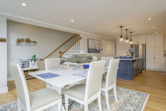 Open concept dining and kitchen area with stairs to the upstairs bonus room .Unit 204, 557 Route 28, Harwich Port, Cape Cod, New England Vacation Rentals