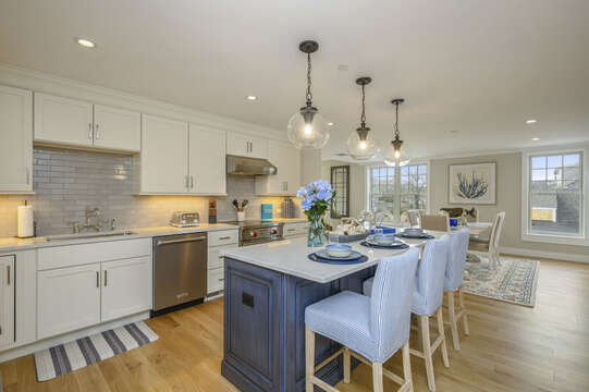 Open Concept Luxury Kitchen and dining room with large center island with seating for 3. Unit 204, 557 Route 28, Harwich Port, Cape Cod, New England Vacation Rentals