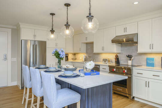 Luxury style Kitchen with stainless appliances , chefs  oven and large center island with seating for 3. Unit 204, 557 Route 28 Harwich Port Cape Cod New England Vacation Rentals