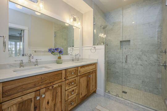 Bedroom 1, en suite bathroom with double vanity and large walk in shower. Unit 204, 557 Route 28, Harwich Port, Cape Cod, New England Vacation Rentals