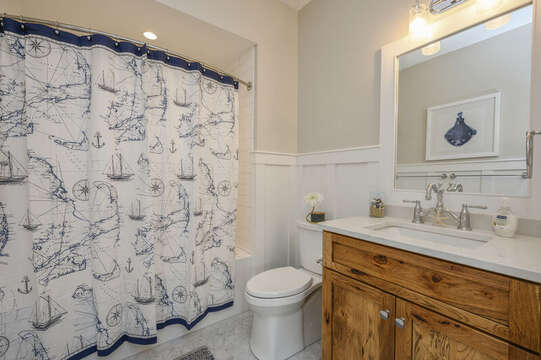 Bathroom #2 off the hallway with shower tub combo in nautical decor.Unit 204, 557 Route 28, Harwich Port, Cape Cod, New England Vacation Rentals