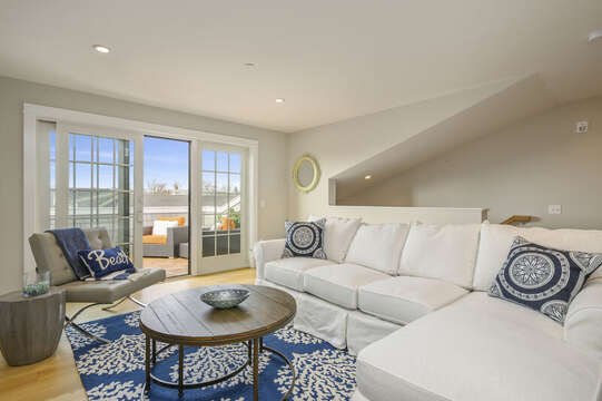 Second floor bonus room with large sectional, leather chair and entrance to roof top terrace.Unit 204, 557 Route 2,8 Harwich Port, Cape Cod, New England Vacation Rentals