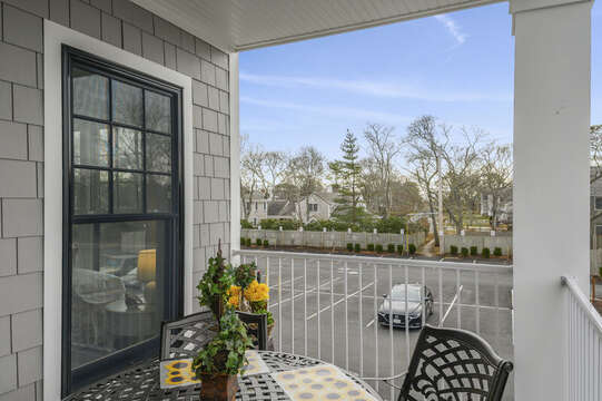 You can see the path in the back of the parking lot from the balcony that leads to the beach! Unit 204, 557 Route 28, Harwich Port, Cape Cod, New England Vacation Rentals